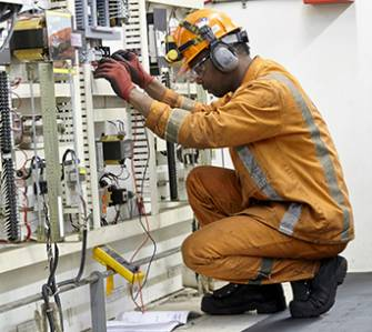 Join Our Team - A Picture of a STELCO electrician testing a panel